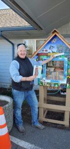 Super volunteer Vicki O showing off OSC Little Free Library.