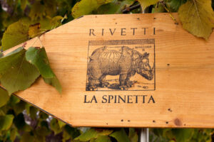La Spinetta Vineyard logo of a rhinoceros burned into a piece of wood.
